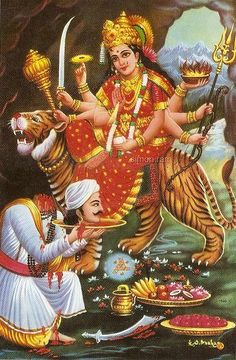 The fiercely beautiful eight-armed goddess riding a tiger isn't the weird part.  She's cool. It's the gentleman offering his severed head on a platter that strikes me as a bit odd. It's a very devoted act, no doubt. It just doesn't look all that practical. Jai mata di