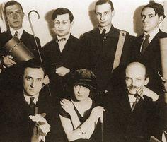 Paul Eluard, Tristan Tzara, Philippe Soupault, Serge Charchoune, Man Ray (photo), Jacques Rigaut, Mick Soupault, unknown woman, and Georges Ribemont-Dessaignes (Paris, 1920).