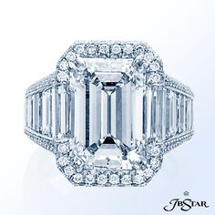 Style 7007 Exquisite 7.00ct emerald-cut ring edged with round diamond pave completed with trapezoid diamonds. Platinum. @jewelsbystar #diamond #engagement #ring #classic