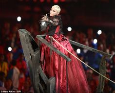 Different look: Annie Lennox made her way to the centre of the stadium on a large pirate-esque ship