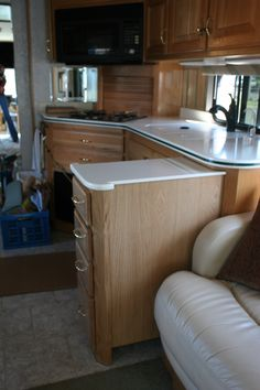 Well designed RV kitchen with appliance garage and pull out cabinet