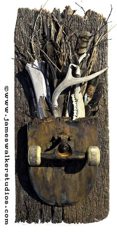 mixed media assemblage with found objects and recycled skateboard parts