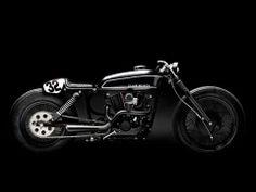 "by Wrenchmonkees...  CLUB BLACK #2 Harley Davidson Sportster Standard frame, engine, swingarm, rear shocks, front fork, wheels, 16"" Firestone Deluxe rear tyre, 19"" Firestone Deluxe front tyre. WM seat and seat cowl, WM tank, WM handlebar. Tarozzi footpegs. WM exhaust. WM custom paint."