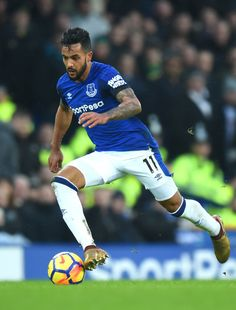 Theo Walcott of Everton runs with the ball during the Premier League match between Everton and West Bromwich Albion at Goodison Park on January 20, 2018 in Liverpool, England.