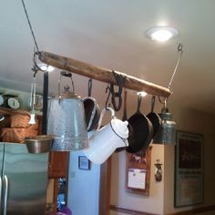 Horse yoke used as a pot rack in the kitchen.  Love this idea!
