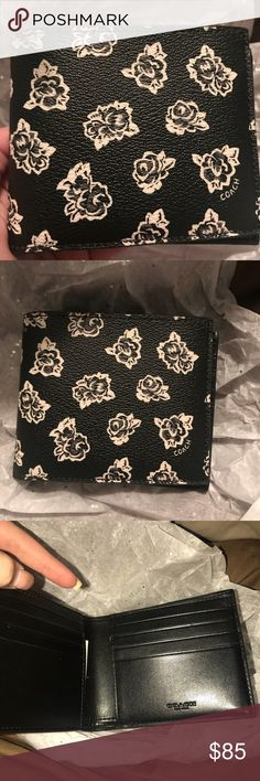 Coach Wallet Great quality floral Coach wallet. Never used but no box! Comes with tag and care card. Bought it for my husband as a gift and he didn't like it lol. Feel free to ask questions or offer! Coach Bags Wallets