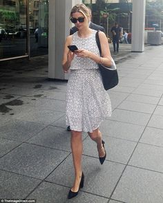 On the go: Ivanka Trump wore chunky black heels with her summery white printed dress from her eponymous collection as she strolled through New York City on Thursday morning