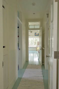 Consider me inspired with these painted seaside-blue floors! House of Turquoise: Andra Birkerts Interior Design House Of Turquoise, Style At Home, Painted Wood Floors, Transom Windows, Blue Floor, Floor Colors, River House, Waterfront Homes, Coastal Homes