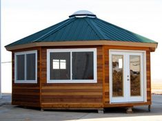 Solargons are octagonal buildings featuring passive solar design principles. Assembly requires hours for the model and less than two days for the model. Wooden House Design, Small Wooden House, Small Tiny House, Tiny House Design, Small Homes, Round House Plans, Small House Plans, Casa Octagonal, Yurt Interior