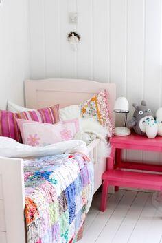 Paint an Ikea stool to use as a bedside