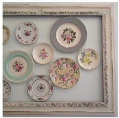 Plate display in frame.  Frame gives more definition.  In darker colors, in kitchen.