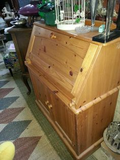 Another old time oregon desk. You can stick laptop inside and hide the mess. Moms love them for teenagers rooms. And guys live them for fly tying!