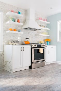 OMG, found my dream kitchen! white kitchen with marble countertops + bright pops of color + (most importantly) super functional.