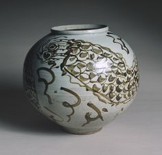 Happy Year of the Dragon  Jar, Joseon dynasty (1392–1910), 17th century Korea Porcelain with underglaze iron-brown decoration of dragon and clouds; H. 13.8 in. (35.5cm) The Cleveland Museum of Art