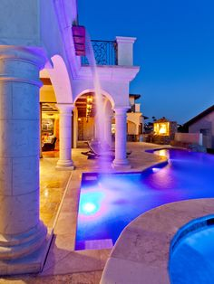 awesome swimming pool, hot tub, veranda/loggia, lounge chair area, outdoor kitchen and water fall!