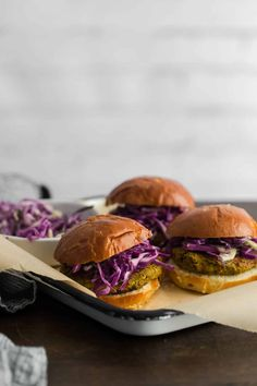 Flavorful and fun vegetarian curry chickpea burgers, topped with an easy coconut cabbage slaw. A perfect weeknight dinner or backyard BBQ.