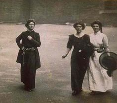 * Surveillance photograph of two suffragette prisoners and a prison warden 1913-1914  The Home Office commissioned the undercover photography of militant suffragettes from 1913. This surveillance photo was taken of two suffragette prisoners as they exercised with a warder in the yard of Holloway Gaol