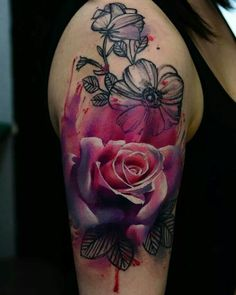 Beautiful rose tattoo! I absolutely love the colors and now want to get a similar style.