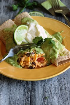 Quinoa Enchiladas with Black Beans and Sweet Potatoes with an Avocado-Cilantro Chili Enchilada Sauce