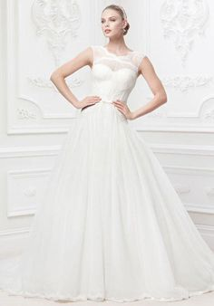 Tulle ballgown with veiled corset bodice of chantilly lace and draped tulle | Truly Zac Posen at David's Bridal | https://www.theknot.com/fashion/zp345016-truly-zac-posen-at-davids-bridal-wedding-dress