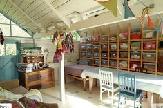 Barn-like studio ~ love the wall with simply built shelving for plastic bins ~