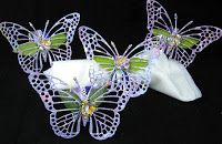 I decided to do a re-use project of napkin rings re-purposed. #cheeryld Dies used: Exotic Butterfly Large #2 - DL118; Leaf - SF-1; Medium Rose - B154; Large Rose - B155 http://www.cheerylynndesigns.com
