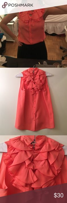J.Crew Silk Coral Ruffle  blouse Beautiful 100% silk j crew Sleeveless blouse. Pretty coral/ peach color! Slight wear in pic 3 but overall great condition. Freshly dry cleaned . Fun neckline / ruffles! J. Crew Tops Blouses