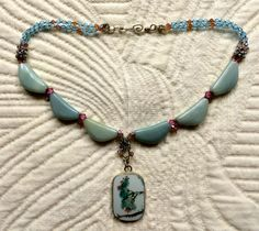 Asian style fragment with Swarovski crystals and Amazonite beads.