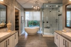 Transitional design elements create harmony, blending classic features of a free standing tub with a new, fresh shape. A steam shower is effortless with the transom glass window built into the seamless shower. Floating, white cabinets create soothing dimension and provide depth to the whole room.