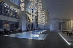 The triple height swimming pool is beautifully designed.