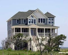<!-- Generated by XStandard version 2.0.0.0 on 2015-01-29T11:12:04 --><ul><li>Classic design blends with contemporary geometric styling in this breathtaking coastal house plan. This plan features a gorgeous, oversized, covered porch off the front, evoking the sense of a traditional seaside village.</li><li>With four bedrooms, including double master suites, this plan offers plenty of room for guests or a large family.</li><li>The entire rear...