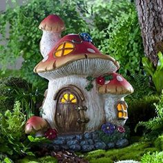 Fairy Mushroom Cottage www.teeliesfairygarden.com In the shadows, beneath the thicket and grass, dwells a whimsical mushroom cottage. Thrill your fairies and other wee folks in your fairy garden with this new abode! #fairycottage