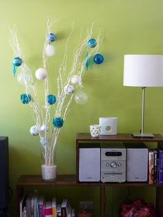 Simply pick up some decorative branches with fairy lights OOOORRR if you wanted to go truly custom then you could go pick up your own branches from outside and spray paint them and string your own lights.  ;)