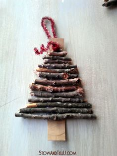Rustic twig and cardboard Christmas tree ornaments - StowandTellU How to make an easy twig Christmas tree ornament using card board, twigs and glue. A cute and rustic holiday craft idea for gifts, decorating and more. Country Christmas Decorations, Christmas Crafts For Kids, Xmas Crafts, Homemade Christmas, Christmas Diy, Christmas Fair Ideas, White Christmas, Natural Christmas Ornaments, Twig Christmas Tree