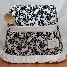 A cute look. I need to make a cover for my Kitchenaid Mixer. (Vine Noir $35.00, via Etsy.)