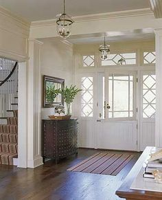 I love Dutch doors, and plan on having one in my own foyer...soon, very soon...    Dutch Door in an Entry  Think Dutch doors are strictly for a side or back entry? Think again. This traditional, elegant door adds clever charm and instant convenience to the space. During warm weather months, the top door can stay open to admit breezes. A transom and sidelights frame the door for a formal look and to stretch the entry from wall to wall.