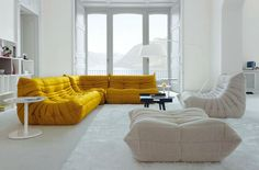Ligne Roset Togo Sectional in yellow...wow! We have this sofa in orange. The most comfortable couch ever!