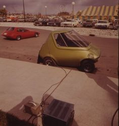 At the First Symposium on Low Pollution Power Systems Development, in Ann Arbor, Michigan, General Motors displayed the Urban Electric Car, a predecessor to the ill-fated EV1.
