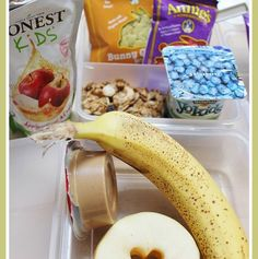 I add a sweet twist on the apple slices by cutting out the core with a small heart-shaped cookie cutter.   What's in her lunchbox: • YoKids blueberry yogurt with granola (main item) • Banana and apples which she dips into • Peanut butter (fruit and protein) • Annie's honey graham bunnies (sweet treat) • Annie's organic fruit snacks • Honest kids apple juice  - Lunch created by Sheila from Pieces of a Mom.