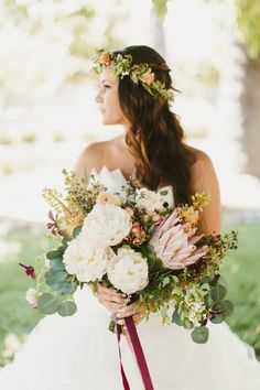 Beautiful floral crown for a beautiful bohemian styled bride. Her large bridal bouquet was made with king protea and peony flowers with accents of eucalyptus leaves.