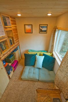 There are two storage spaces, plus several other built-in storage areas.
