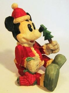 Santa Mickey Mouse as a sitting marionette figure