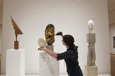 Art conservation interns prepare objects for exhibition