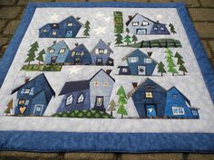 Love the winter colors of this Piece o' Cake village quilt House Quilt Patterns, House Quilt Block, House Quilts, Quilt Festival, Colchas Quilting, Quilting Projects, Quilting Designs, Hanging Quilts, Quilted Wall Hangings