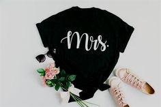 Bride #Shirt Gift for Wife.………………………………….G A R M E N T • F E A T U R E S :• Unisex Heavy Cotton #Tee• Classic fit• Tear away label• Runs true to size• Light fabric (5.3 oz/yd² (180 g/m²))• 100% Cotton…More #bachelorette #gifts #shirts #personalizedshirt #customshirt #bachelorettepartyshirt #bacheloretteshirts #gift #etsy #bachelorettepartygifts #bachelorettetshirt #tshirts #etsyclothes #bachelorettegifts Brides Basket, Bachelorette Party Gifts, Bride Gifts, Gifts For Wife, Bridesmaid Gifts, Cotton Tee, Custom Shirts, Label, Unisex