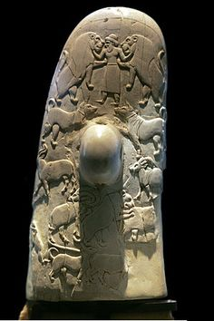 A god with two lions on the back of the handle of the Gebel el-Arak Knife c. 3450 BCE. The Gebel el-Arak Knife is an ivory and flint knife dating from the Naqada II d period of Egyptian prehistory, starting circa 3450 BC, showing Mesopotamian influence.