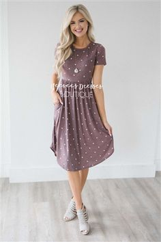 This adorable polka dot dress is Spring perfection! Cute Dusty Burgundy dress features tiny white polka dots, has an elastic waist, short length sleeves, and adorable side seam pockets!