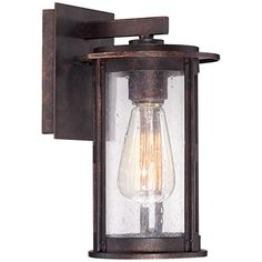 This lovely seedy glass outdoor wall light with bronze finish makes the perfect lighting solution for porches and entryways.  The bronze finish on this contemporary outdoor light feels industrial; while the seedy glass feels cozy and rustic. Say welcome with style by placing this gorgeous light near an entryway or porch. From Franklin Iron Works™.