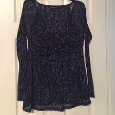 INC dressy top Gently used.  Black and blue pattern.  Sleeves are see through.  Gathers in the front near the chest area. INC International Concepts Tops