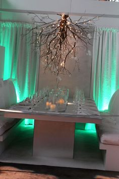 tablescapes -- (Previous pinner said):this gave me an idea: hang white Christmas lights across room but with a loop hanging down at the centre of each table. the loop can be stuck in a paper lantern or decorated in other ways.